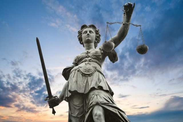 Statue of lady justice 696x463